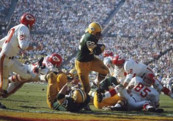 Green Bay Packers' Elijah Pitts #22 runs with the ball during Super Bowl I against the Kansas City Chiefs at Memorial Coliseum on Jan. 15, 1967 in Los Angeles.
