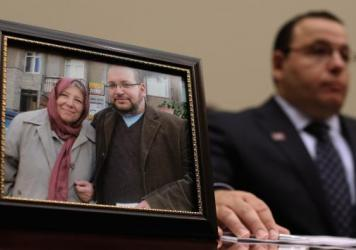 Ali Rezaian, brother of Washington Post Tehran Bureau Chief Jason Rezaian (shown in picture frame), talks about his brother's imprisonment in Iran while testifying before the House Foreign Affairs Committee on June 2, 2015. Iranian media outlets are repo
