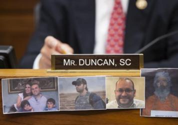 Congressman Jeff Duncan displays pictures of Saeed Abedini, Amir Hekmati, Jason Rezaian and Robert Levinson during a House Committee on Foreign Affairs hearing in Washington, D.C. on July 28, 2015. Abedini, Hekmati and Rezaian were freed this weekend as