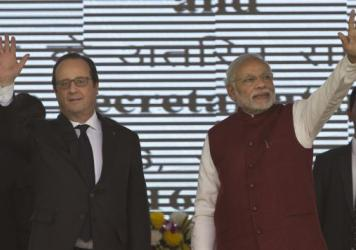 French President Francois Hollande (left) and Indian Prime Minister Narendra Modi arrive for a ceremony Monday to lay the foundation stone for the headquarters of the International Solar Allliance at Gurgaon, on the outskirts of New Delhi, India.