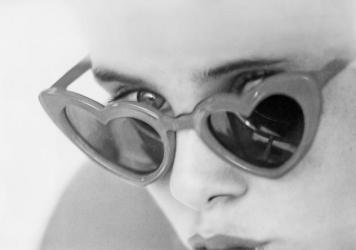"Actress Sue Lyon eats a lollipop as Dolores ""Lolita"" Haze in a scene from <em>Lolita</em>, the 1962 film adaptation of Vladimir Nabokov's novel. Nabokov made sumptuous use of food in his writing, and the acoustic affinity between Lolita and lollipops is no coincidence."