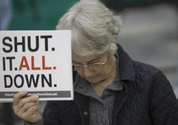 A woman attends a public hearing about the gas leak before the South Coast Air Quality Management District. The agency has ordered Southern California Gas Co. to permanently shut down the well, and is suing the company for negligence.