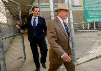 "Robert Durst's attorney, Dick DeGuerin (right), seen here in March 2015, often dons a Stetson Open Road, just like the cowboy hat worn by former President Lyndon B. Johnson, a friend of his father. ""He was a giant of a man, and he'd pick me up and put me on his knee,"" DeGuerin says."