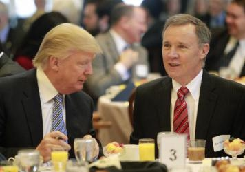 During more cordial times, Donald Trump (left) talks with New Hampshire <em>Union Leader</em> Publisher Joe McQuaid during a Politics and Eggs breakfast in Manchester, N.H., in 2014.