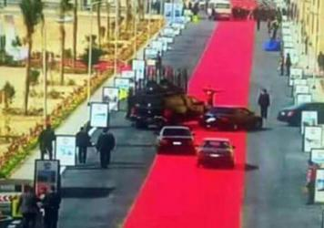 Egyptian President Abdel-Fattah el-Sissi's motorcade drives on a red carpet during a trip to open a social housing project in a suburb of Cairo on Saturday. One local newspaper devoted its entire front page Monday to accusing Sissi of decadence even as h
