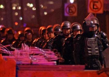 Riot police were deployed Wednesday night outside Topo Chico prison in Monterrey, Mexico, where at least 52 people died in rioting and a fire.
