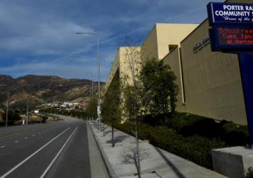 Deserted streets and a sign advising students to attend another school are seen in this photo of the Porter Ranch Community School, taken in January.