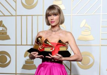 Taylor Swift won three Grammy Awards, including Album of the Year, for her album <em>1989.</em>