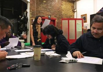 Lily Cheung teaches Mandarin to Greg Wong (left), Lt. Charles Flores (right) and other New York City firefighters, EMTs and paramedics at an old firehouse. The city is predicting that Chinese residents are likely to become New York's largest immigrant gr