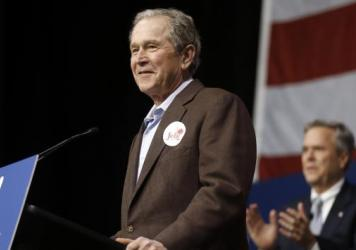 Former President George W. Bush, left, introduces his brother Republican presidential candidate and former Florida Gov. Jeb Bush during a campaign stop in South Carolina Monday.