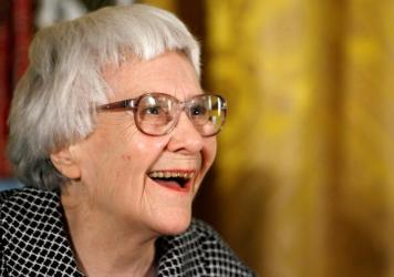 Pulitzer Prize winner and <em>To Kill a Mockingbird</em> author Harper Lee smiles before receiving the 2007 Presidential Medal of Freedom at the White House.