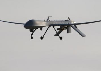A U.S. Air Force MQ-1B Predator unmanned aerial vehicle, carrying a Hellfire missile, lands at a secret air base after flying a mission in the Persian Gulf region on Jan. 7.