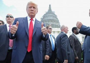 Republican presidential candidate Donald Trump gives a thumbs up to photographers during a rally against the Iran nuclear deal at the Capitol last year. Marco Rubio still leads the GOP pack in congressional endorsements, with more than 50.