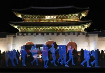 "Holograms of human figures are displayed during a ""ghost protest"" against South Korea's president in front of the Gyeongbok Palace in Seoul on Wednesday. Amnesty International in Korea said it decided to use the holograms after protesters were denied permission to march. See the video below."