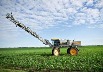 A farmer applies fertilizer to soybeans in Kasbeer, Ill. Scientists say one significant source of nitrogen pollution is fertilizer that leaks off of fields growing corn and soybeans to feed meat and dairy animals.
