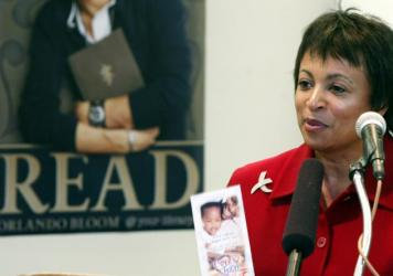 Then-American Library Association President Carla Hayden holds a pamphlet promoting early literacy as she talks to reporters in 2004.