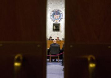 Director of the National Intelligence James Clapper, seated at the table meets with the Senate Intelligence Committee Feb. 9, including Chairman Richard Burr, R-N.C. Burr and the committee's minority leader, Sen. Dianne Feinstein, D-Calif., are working on a bill that would force companies like Apple to help prosecutors unlock the phones of criminal suspects.