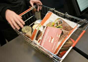Two women shoppers at Copenhagen's WeFood grocer. Per Bjerre with DanChurchAid, the charity behind WeFood, says some of the shoppers flocking to the store are low-income people looking for a deal. But mostly, he says, they're here for more political reas