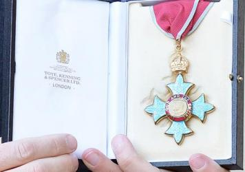 A medal denoting a Commander of the Order of the British Empire (CBE) is seen here at a ceremony last month. Under a new contract, a French company will make some of Britain's medals.