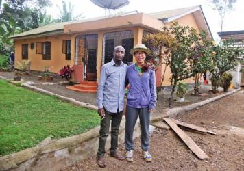 Godwin Ndosi of Tanzania (center) rents rooms in his family home through Airbnb and sometimes takes guests to visit his relatives, including his aunt and uncle (flanking Ndosi).