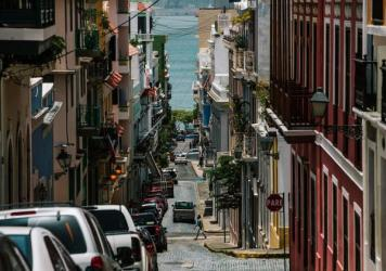 Blue skies in San Juan, Puerto Rico belie the U.S. territory's struggle with massive debt. The islands have a generous health care program that covers nearly everyone, but economists say it has never been adequately funded.