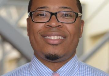 Prof. Erik Hines, director of the Scholars House at the University of Connecticut. The Scholars House is a community to help keep black male students in school.