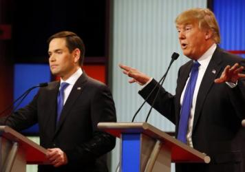 Republican presidential candidate Donald Trump, right, gestures with his hands Thursday as Sen. Marco Rubio, R-Fla., listens to Trump's response during a Republican presidential primary debate in Detroit.