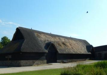 The Tithe Barn at Avebury, owned by the U.K.'s National Trust, is home to a museum dedicated to the Avebury Henge. It's also now, unhappily, home to a very damaged thatched roof.