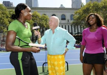 Venus Williams (left) and Serena Williams are interviewed by Bud Collins before the 2009 U.S. Open.