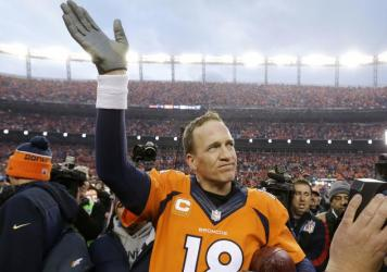 Denver Broncos quarterback Peyton Manning waves to spectators following the AFC Championship game between the Denver Broncos and the New England Patriots, in Denver.