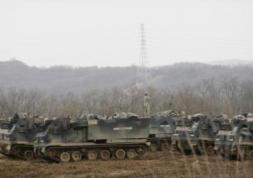 "A U.S. soldier stands on an armored vehicle during an annual exercise Monday in Yeoncheon, South Korea, near the border with North Korea. Pyongyang threatened a ""preemptive nuclear strike of justice"" in retaliation for the joint training exercises."