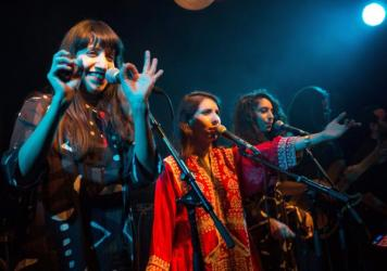 Israeli sisters (from left to right) Liron, Tair and Tagel Haim, who make up the band A-WA, perform in Jerusalem.