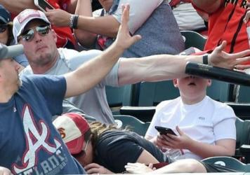 Shaun Cunningham blocked a baseball bat that was helicoptering toward his son's head at a spring training game this weekend.