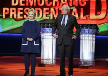Democratic presidential candidates Hillary Clinton and Sen. Bernie Sanders stand on stage before a Democratic presidential primary debate March 6 in Flint, Mich.