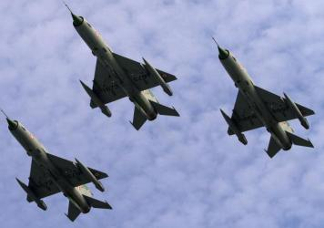 Indian Air Force jet fighter aircrafts fly over an airbase in 2014. Starting this summer, female fighter jet pilots will be allowed in the Air Force.