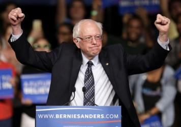 Democratic presidential candidate, Sen. Bernie Sanders, I-Vt. acknowledges his supporters on arrival at a campaign rally, Tuesday, March 8, 2016, in Miami.