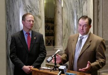 Missouri Senate Majority Leader Mike Kehoe (right) talks with reporters as fellow Republican Sen. Bob Onder looks on Wednesday at the state Capitol in Jefferson City, Mo.