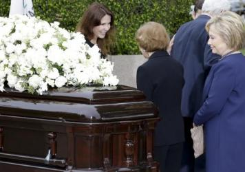 Patti Davis (left) greets Rosalynn Carter as Hillary Clinton looks at the casket during the graveside service for Nancy Reagan at the Ronald Reagan Presidential Library on Friday in Simi Valley, Calif.