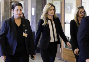 Sportscaster Erin Andrews, center, was awarded $55 million on Monday in a lawsuit she filed against a Marriott hotel and a man who admitted to filming Andrews nude through a hotel door peephole.