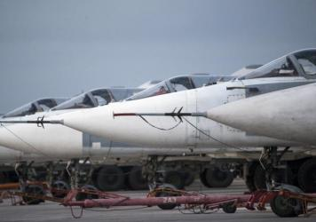 Russian bombers parked at Hmeimim air base in Syria on March 4. Since the cease-fire began in late February, the warplanes have mostly stayed on the ground.