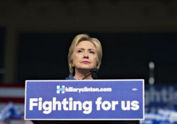Hillary Clinton pauses while speaking during at her primary night rally in West Palm Beach, Florida, on Tuesday.