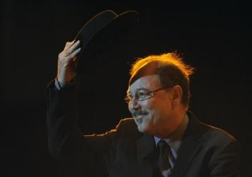 Panamanian salsa singer Ruben Blades waves to the crowd before performing during the final round of Tango Salon competition at the 8th Tango Dance World Championship in Buenos Aires on August 30, 2010. MABROMATA/AFP/Getty Images)