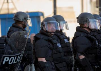 Police stand guard during demonstrations in reaction to a Cleveland police officer being acquitted of manslaughter charges on May 23, 2015 in Cleveland, Ohio.