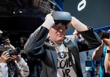 "Palmer Luckey, co-founder of Oculus VR, demonstrates the new Oculus Rift headset during the ""Step Into The Rift"" event in San Francisco in June 2015."