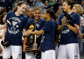 UConn's Breanna Stewart (left) celebrates with her teammates after winning last year's national championship.