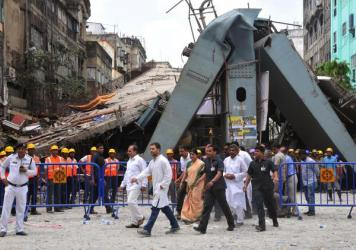 Rahul Gandhi (center left), vice president of the All India Congress Committee, and Adhir Ranjan Chowdhury (center, second from left), state president for West Bengal Pradesh Congress Committee, visit the site of a collapsed highway overpass in Kolkata on Saturday. Rescue officials said Friday there are no more survivors trapped under the rubble.