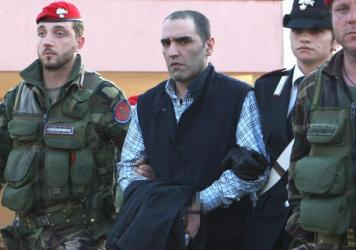 Salvatore Coluccio, alleged head of Calabrian mafia crime group 'Ndrangheta, is one of many mafiosi children born into the family business. He's seen being escorted by police special forces following his 2009 arrest.