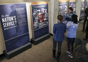 "Princeton University students walk through an exhibit titled ""In the Nation's Service? Woodrow Wilson Revisited,"" at the Woodrow Wilson School of Public and International Affairs in Princeton, N.J."