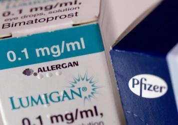 A box of Lumigan eye-drops, produced by Allergan Plc, stands next to a box of Viagra tablets, produced by Pfizer Inc. The Irish and American drugmakers were planning to merge, but the deal has been called off after a change in U.S. tax law reduced the potential benefits.