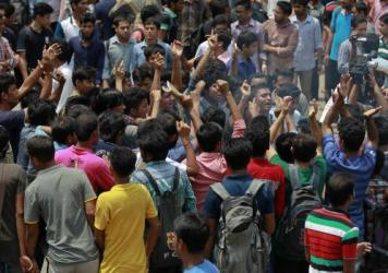 Bangladeshi students protest on Thursday, seeking the arrest of three motorcycle-riding assailants who hacked and shot student activist Nazimuddin Samad to death as he walked with a friend in Dhaka, Bangladesh.